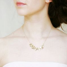 This delicate necklace is made with beautiful, matte gold orchids and attached to a delicate 14k gold fill chain. The length can be worn at