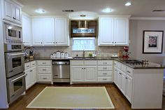 .Double ovens. Love counters with the white cabinets