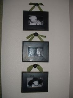 Use cabinet knobs to hang pictures. Great Idea for those picture frames that don't have good hanging options on the back