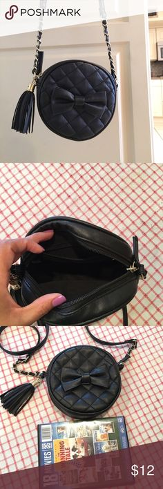 Black quilted crossbody purse Small black quilted crossbody purse. In good condition bought it at local boutique Bags Crossbody Bags