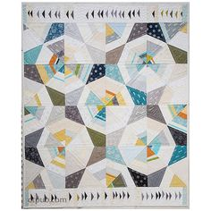 This kit includes all the fabric necessary for the top and binding of the Octagon quilt featuring Shimmer 2 by Jennifer Sampou.   The pattern is included.