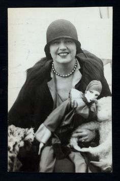 Gloria Christy with boudoir doll and monkey