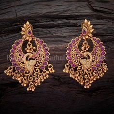 Earrings Studs Designer antique earrings studded with synthetic ruby stones, plated with gold polish and made of copper alloy Gold Jhumka Earrings, Silver Earrings Online, Indian Jewelry Earrings, Jewelry Design Earrings, Gold Earrings Designs, Gold Jewellery Design, Ear Jewelry, Antique Earrings, Gold Necklace
