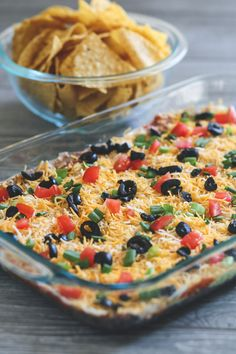 Classic 7 Layer Mexican Dip Recipe - Make Your Meals - - A delicious dip made with 7 layers of classic Mexican flavors and topped with tomatoes, olives and green onions. 7 Layer Mexican Dip, Mexican Dip Recipes, Bean Dip Recipes, Seven Layer Dip, Mexican Appetizers, Appetizer Dips, Appetizer Recipes, 7 Layer Bean Dip, 7 Layer Taco Dip