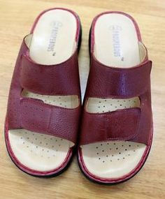 be prosperous tm A278 Orthopedic Slippers Orthopedic leather thongs, two straps with Velcro   Really news locked only once    Red / Bordeaux color (you can see in the pictures)  quality Clogs, women's orthopedic and comfort.  2 velcro straps, for better fitting.  Size:  U.S- 8.5 / EUR - 39