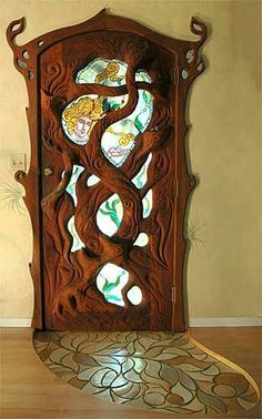 Tree branch door with stained glass