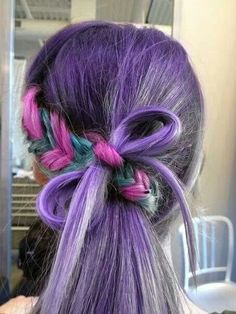 Purple pony with pink and green fish tail braid