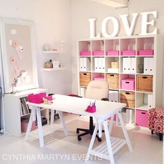 Pretty pink and white craft space.