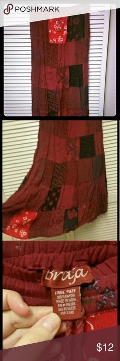 """Patchwork boho skirt Cute, flowy, dust fabric patchwork style boho hippy skirt. Never worn because I'm terrible about Color coordinating my wardrobe! Fits up to 47"""" hips, purchased when I was larger and heavier, lots of stretch. Braja Skirts Maxi"""
