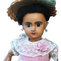Offered is a VERY PRETTY 1907 Bebe Jumeau with a lovely amber brown complexion and wearing a lovely antique ensemble, 14 inches tall. She has a perfect bisque socket head with large brown glass