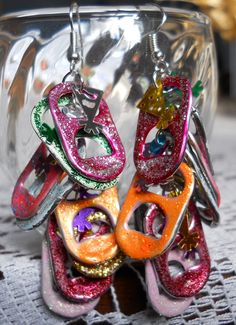 These wild earrings are all Handmade with Multicolored Glitter Glue Pop Tabs and Sequins that are sure to glitter and sparkle on your ears! Connected by fish/french hook wire