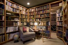yahighway: A reading room with a secret wine cellar?! Literally the room of my family's dreams. When I grow up, my house is going to look like that.