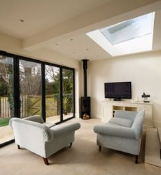 Surrey-based homeowners specified our market-leading SkyView rooflight to create a spectacular feature for their single storey extended living space. Bungalow Renovation, Open Plan Kitchen Dining, Open Plan Kitchen Living Room, Open Plan Kitchen Dining Living, Open Plan Kitchen, Room Extensions, Log Burner Living Room, Open Plan Living, Garden Room Extensions