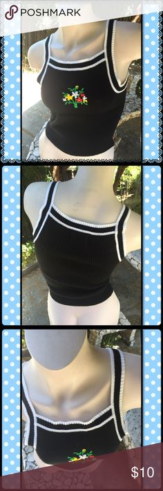 """Vintage flower top Black Acrylic top with cute embroidered flower detail!  Size small. Stretchy. About 14"""" armpit to armpit. 17"""" top (back) to bottom. Tops"""