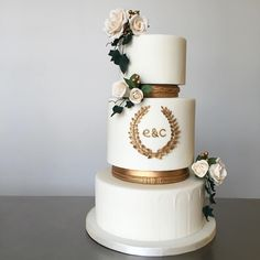 Ancient Greece / Greek themed three-tier wedding cake with gum paste roses, ivy and gold laurel wreath monogram by @xannybakes