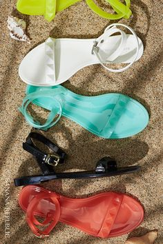 Colorful studded jelly sandals add a pop of luscious color to any summer look. Comfortable enough for beach combing or BBQ and cool enough for city streets and warm summer date nights. These are the neon, coral, black, white and mint flats to collect now.