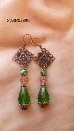 Luxurious Pretty Earrings! To make these I Used Swarovski Crystal Green Tear Drop Beads, Pink Swarovski Crystal Beads, Green Swarovski Crystal Beads, Copper Floral Bead Cap and Vintage Rhinestone Spacer Beads. I then Added Copper Daisy Spacer Beads with Copper Filigree French Ear Wire. They Measure 1 1/4 Inches Long, not including the Ear Wire. They will be packaged sweetly, ready to receive or give as a gift.