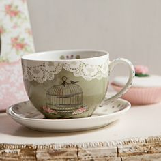 Pretty birdcage tea cup