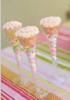 Champagne glasses filled with candy, topped with cupcakes!!!