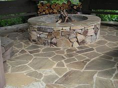 Google Image Result for http://www.ambroselandscapes.com/projects/stonework_samples/images/more/stone-firepit-with-patio-360px.jpg