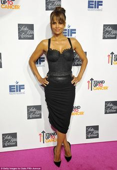 Va va voom!Halle Berry spellbound in the flirty frock that clung to her curves and had a lacy neckline as she attended Saks Fifth Avenues' celebration of Key To The Cure in Beverly Hills on Monday