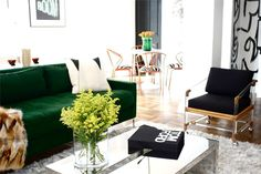 I love the green sofa, it changes from all the black and white interior we are seeing in every magazines