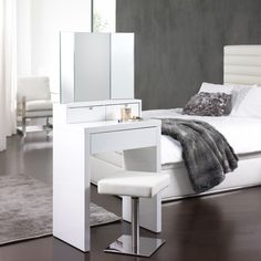 This small dressing table has a small foot print allowing even the smallest of bedrooms to accomodate a dressing table. The fixed mirror gives you a 180 degree view of yourself at just a glance.