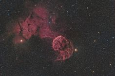 Wide field image of the supernova remnant IC 443 (Jellyfish Nebula). The stars η (right) and μ (left) Geminorum, the diffuse emission from (north), and the partial shell (center) are visible. Medusa, Explanation Writing, Crab Nebula, Neutron Star, Astronomy Pictures, Nasa Images, Pink Stars, Bright Stars, Nebulas