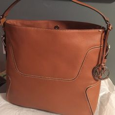 ✨MK SALE✨Beautiful Brown Leather MK bag 100% authentic, beautiful brown leather with stitch detail make this bag a must, NWT, perfect condition, use offer button Michael Kors Bags Shoulder Bags