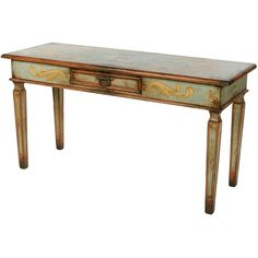 Feminine and ladylike, this versatile console table can act as a table or small writing desk. The pretty aqua blue finish is capped off with a wooden top and is...
