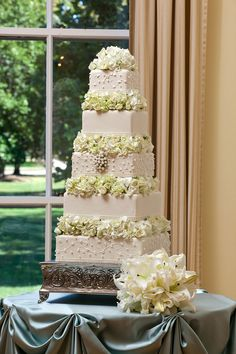 10-tiered white wedding cake with flowers   BomBon Cake Gallery   Taylor & Co.   Wedding Guide Chicago