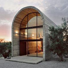 Minimalist Rounded Concrete Studios - A31 Architecture Creates a Simplistic Warehouse Art Studio (GALLERY)