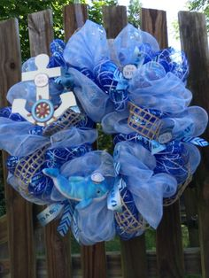 It's a Boy deco mesh wreath, nautical theme with whale and anchor by ShellysChicDesigns on Etsy https://www.etsy.com/listing/190256439/its-a-boy-deco-mesh-wreath-nautical