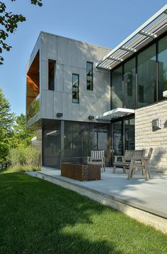 glass-lake-house-features-modern-silhouette-of-earthy-materials-11.jpg