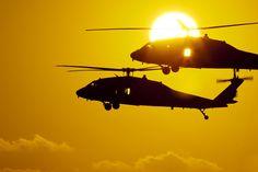 IDF UH-60 Black Hawk Rides The Sun by NGPhoto.biz Black Hawk Helicopter, Helicopter Plane, Military Helicopter, Military Aircraft, Military Photos, Military Art, Sunset Silhouette, Dawn And Dusk, Army Life
