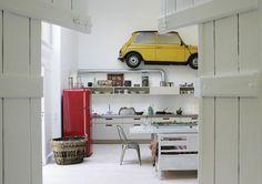 white kitchen with red smeg refrigerator