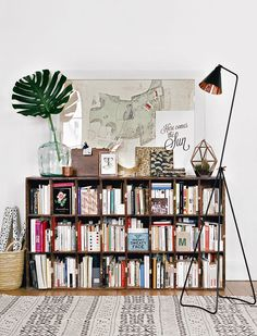 A loaded bookshelf softens vintage & industrial elements // from Glamour Paris