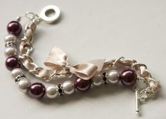Made with 10mm and 12mm glass pearls, rhinestone rondelles, beige satin ribbon and silver plated chain