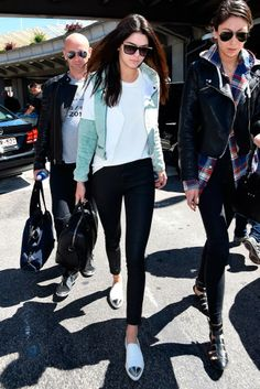 Kendall Jenner kept it casual in a stylish mint Timo Weiland bomber jacket, leather look jeans and silver toe cap flats.