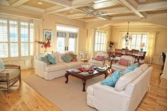 Traditional living room with plantation shutters and white couches