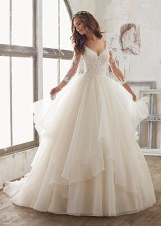 Let Morilee Madeline Gardner help you look like a princess on your big day with her incredible ball gowns: http://www.stylemepretty.com/2017/02/28/5-of-our-fave-fairy-tale-ball-gowns-with-a-twist/ #ad