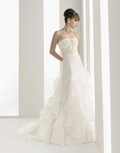 Strapless with empire waist A-line tulle wedding dress $403.00...I question how it can be priced so low. China??
