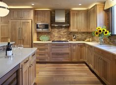 Kitchen with Wooden Tile Backsplash and wooden cabinetry
