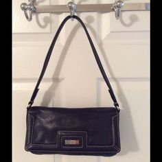 Kate Spade Black Pebbled Leather Shoulder Bag Gold hardware.  Magnetic flap closure.  Interior zip pocket.  Great condition but interior is dirty.  Leather.  Measures: 10.75x1.75x6x10. kate spade Bags Shoulder Bags