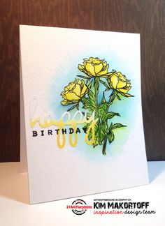 First I created a mask of my rose (Blossom Overture set) and used it to stamp my trio of roses.  I coloured them in with my Spectrum Aqua markers (Teal, Navy, Bud Green, Yellow) using my water brush.  I let the colours bleed on purpose.  Then I die cut the happy and sponged on Mustard Seed Distress ink on it creating an ombré look.  I attached it to my card and then stamped the birthday (Vignette: Chevron and Arrows set) in black.