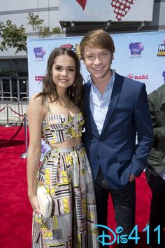 Maia Mitchell and Calum Worthy