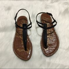 Sam Edelman Gigi thong black leather sandal with stacked heel. USED, please zoom into pics so you can see flaws. Has cushioned foot bed and adjustable ankle strap. 😁 has plenty of life left. By the way the green spot on left sandal is reflection of my tv. Open to offers. Box not included.