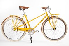 """This the """"legacy edition"""" of Heritage bike's mixte, the Daisy. The color is apropos and the look is all class. I especially like the way the wooden rims coordinate with the Brooks saddle and handlebar grips and contrast with the yellow."""