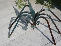 Garden junk :: Metal bug image by jomarkind - Photobucket