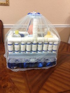 Unique and Original design for DIAPER CRIB. It includes its baby doll inside, brings a baby lotion bottle,and a body wash with its sponge. It is a beautiful imitation of a baby crib or for a baby shower. An original and elegant centerpiece or a nice gift for a baby shower. Has 40